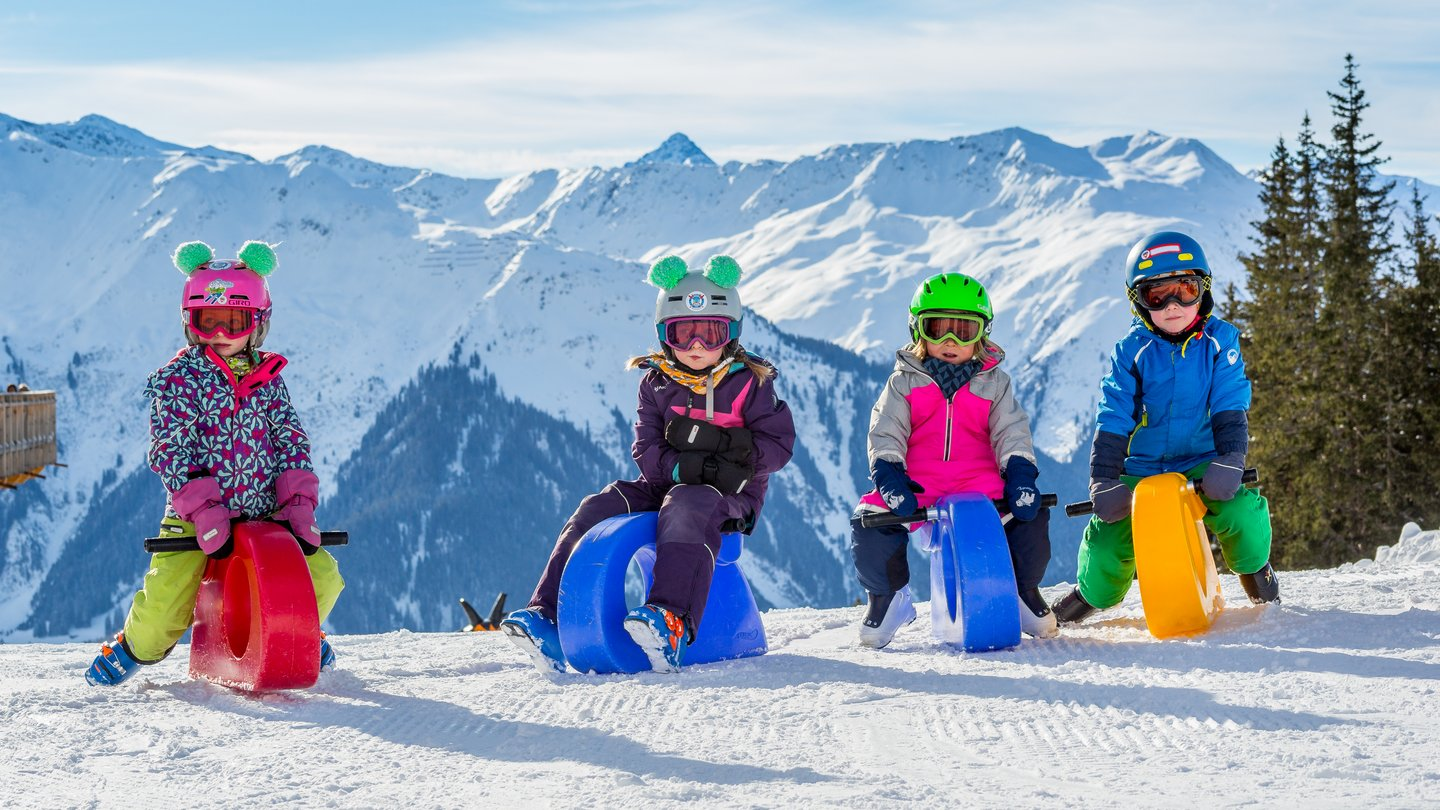In the practice area on Madrisa in Klosters, Switzerland, children glide playfully through the snow on funriders.