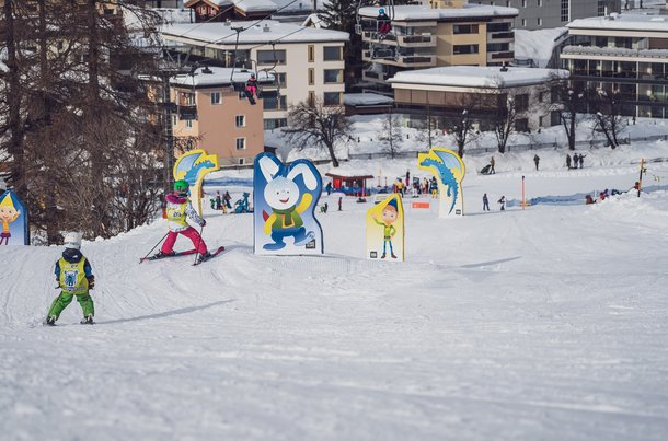 "On the new ""Kids Slope Home of Winter"" at Carjöl in Davos, children discover the story of the snow dragon Flurin while skiing."